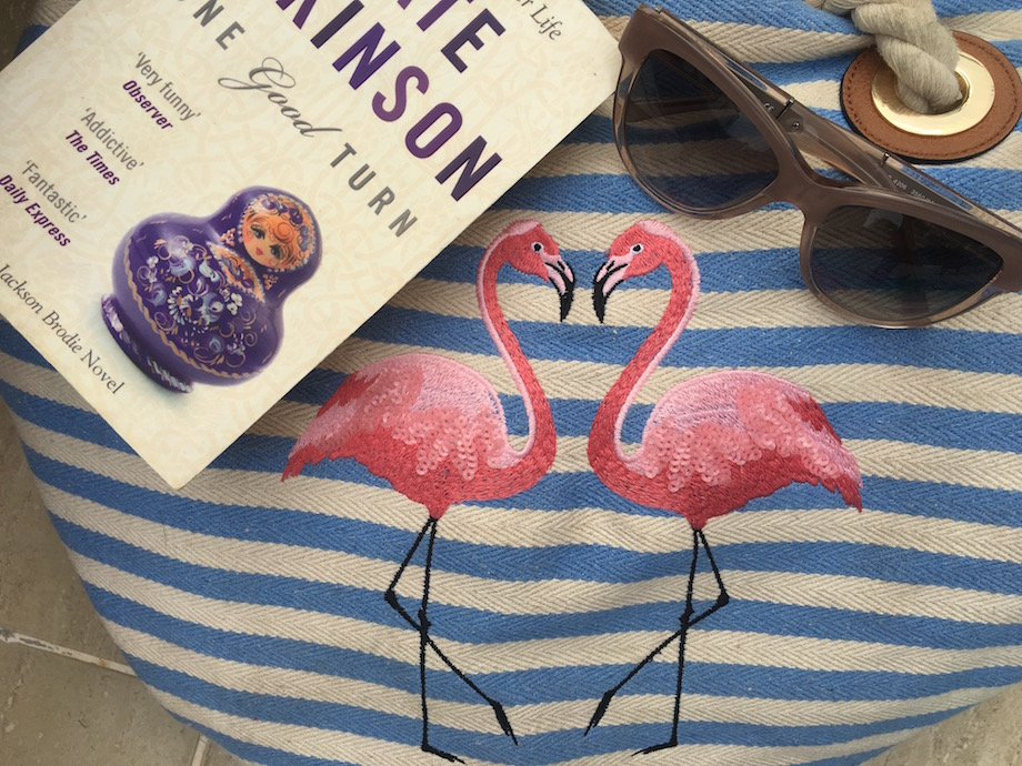 Flamingo bag, book and Burberry glasses for summer holiday