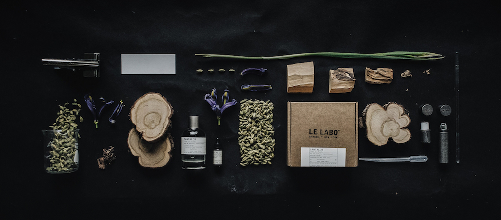 Sntal 33 from le labo ingredients and dark background