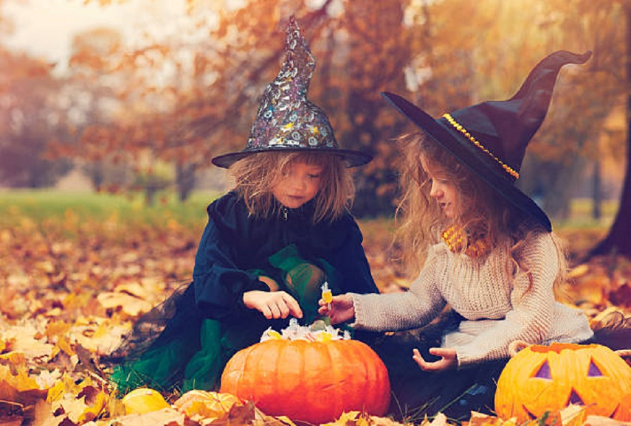 Two kid witches in autumn