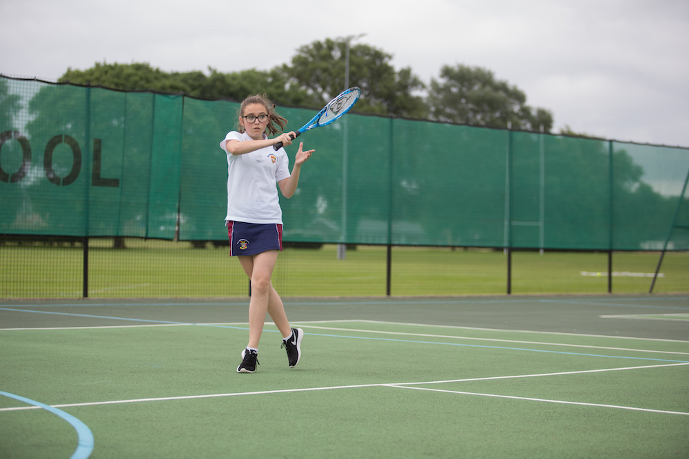 Girl playing Tennis at Wellingborough school tennis courts