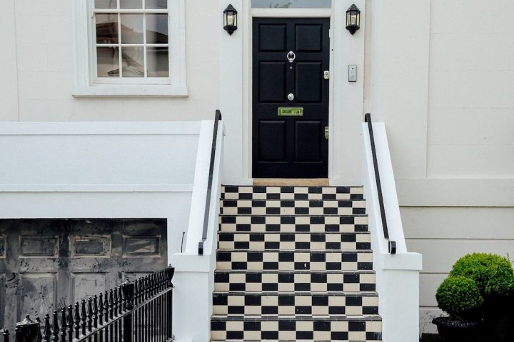 Beautiful black and white tiled steps into front door